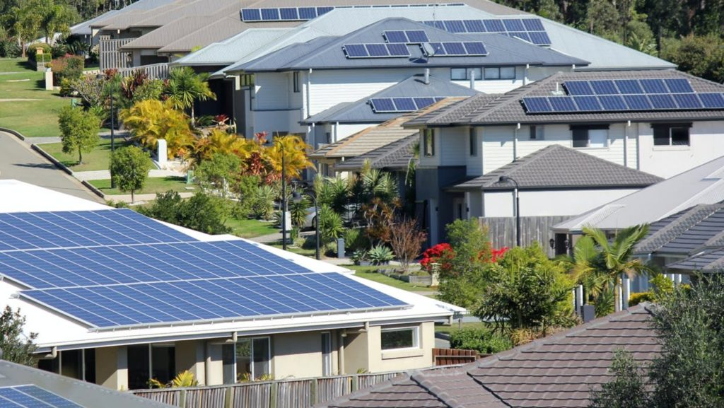Solar panels on the rooftops of Australian suburban homes increase property appeal and prices.